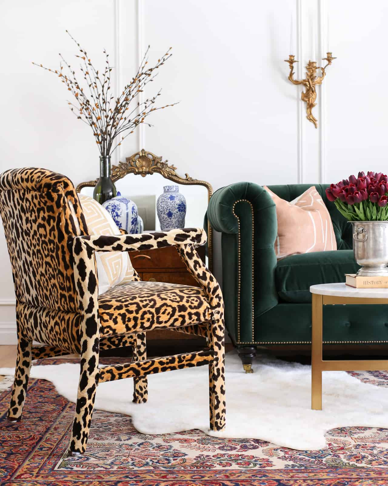 interior-design-green-sofa-leopard-chair-glam-living-room