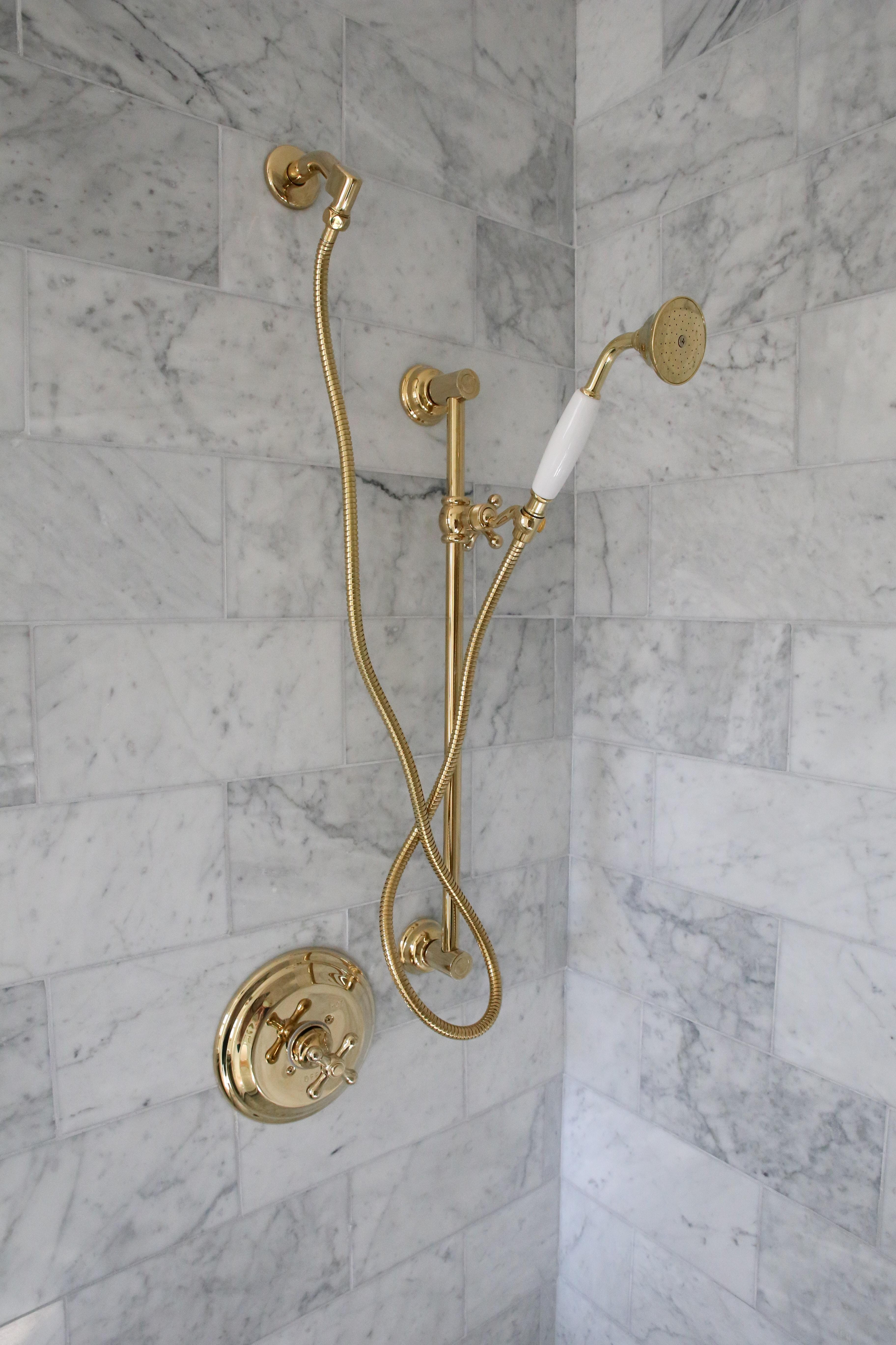 marble-carrara-shower-brass-fixtures