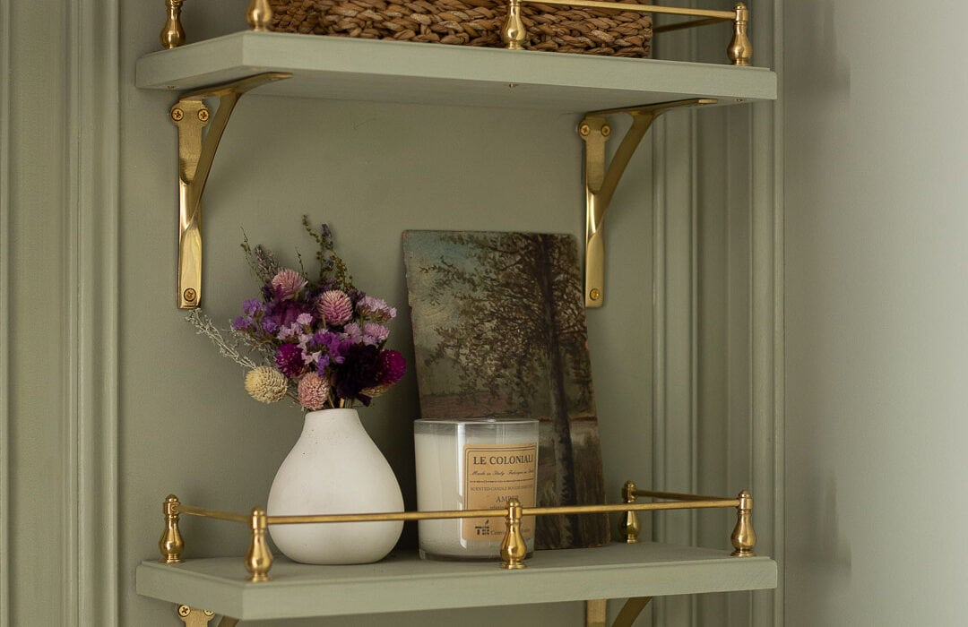 DIY: HOW TO BUILD SHELVES WITH BRASS GALLERY RAILS