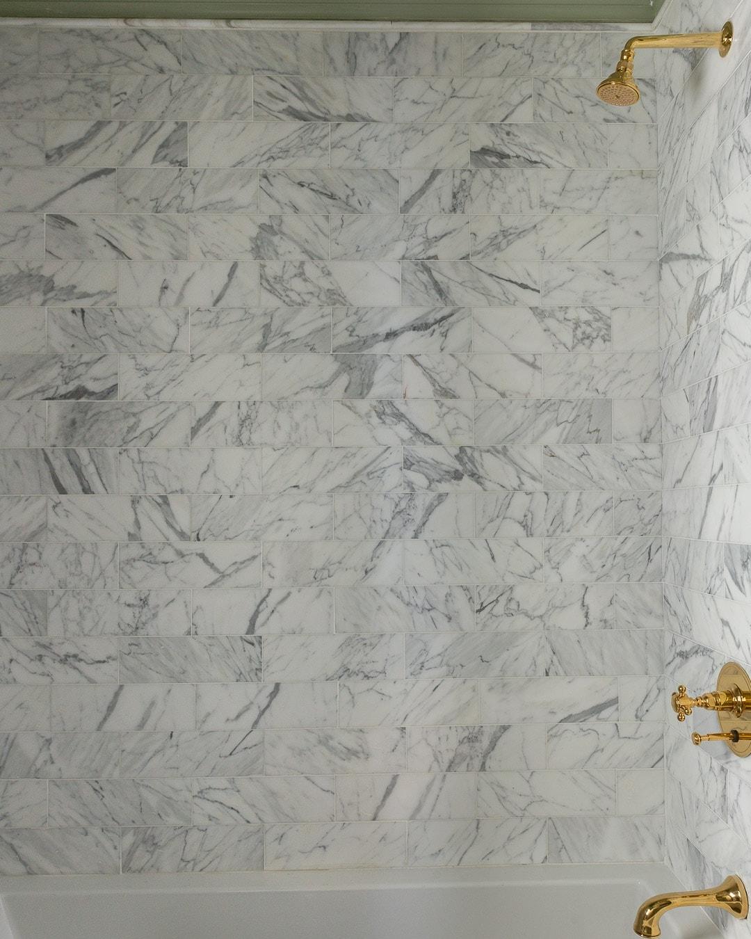 gold-calacatta-marble-shower-tile-signature-hardware-tub
